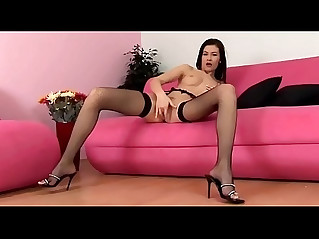 Pretty brunette masturbates in fishnet stockings